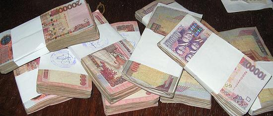 [Image: FLICKR_Ghana_Money_FelixKrohn_550-x235.jpg]